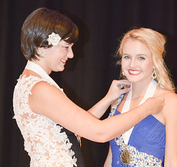 Above: Seven beautiful young women vyed for the title of Escambia County's Distinguished Young Woman. Above: Last year's winner Ryan Garmeson places a medal around winner Morgan Manning's neck.