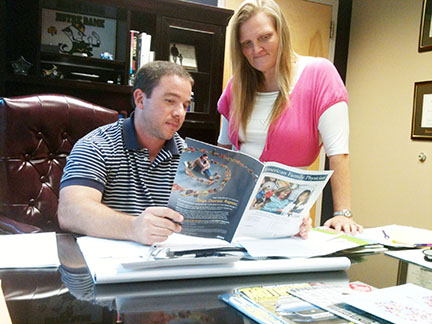 Dr. Aaron Morgan and nurse practitioner Paula Kennedy study an industry magazine.