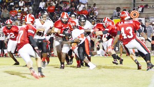 Tigers pounce on a Hillcrest runner during Friday night's win.
