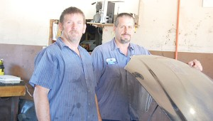 Joel Migas, right, works with his brother, Jim DeRidder, left, at their business in Riverview.