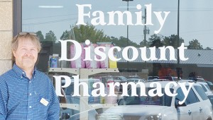 Family Discount Pharmacy owner Russell Sheldt stands in front of the store Tuesday.