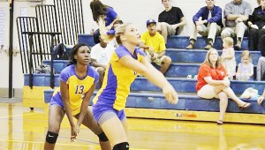 Neal's Madison Winchester makes a play on the ball while teammate Dinah Samuel looks on