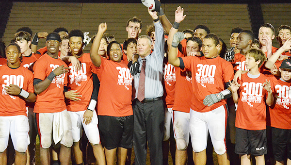 TRM head coach Jamie Riggs with his football team after its victory over Escambia County. The win marks Rigg's 300th win of his head coaching career.