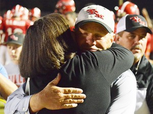 Coach Riggs and his wife, Becky, share a moment after Riggs milestone night.