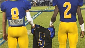 W.S. Neal players carried Taylor's jersey onto the field before the start of Friday's game.