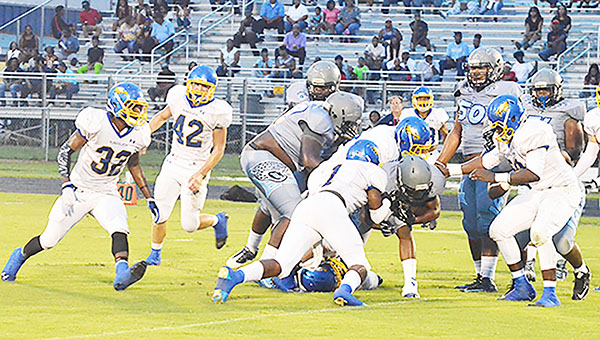 WSN earned a big win Friday as the team traveled to Tallahassee, Fla., to take on the East Gadsden Jaguars. Here, a host of Eagles down the runner near the 20 yard line.