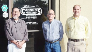 The Cannons – James, Dewayne and Aaron – pose in front of the store.