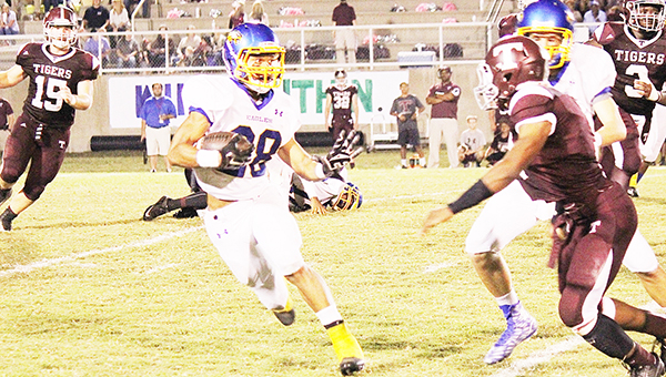 Senior running back Quentin Samuel tries to manuever around a Thomasville defender in Friday night's game. The Eagles had  313 total yards of offense.