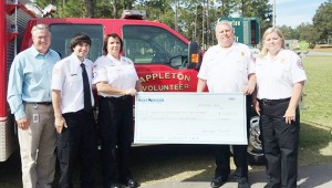Courtesy photo Georgia Pacific awarded Appleton Volunteer Fire Department an $8,000 grant. Pictured are GP general manager Jeff Joyce and Appleton VFD members Devin Cibene, Helen Jackson, Chief Michael Tyler and Ginny Tyler.