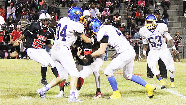 Eagles make a play on a Panther runner in Friday's game at Southside Selma.