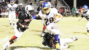 WSN's Quentin Samuel stiff-arms a Panther defender Friday at Southside Selma.
