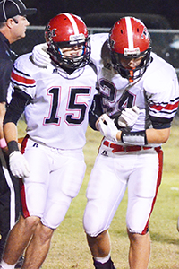 Teammates Joshua Winton and Bryce Brown celebrate after Winton's touchdown catch in the third quarter.