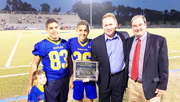 Scott Fountain, a 1984 WSN graduate and current assistant coach at Auburn University, was inducted into the school's hall of fame. He is pictured with his family and superintendent John Knott.