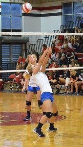 Neal senior Madison Winchester returns the ball over the net Thursday night