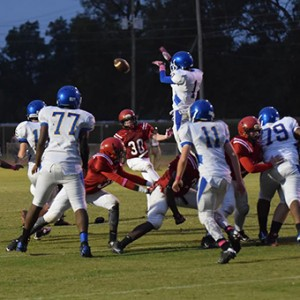 Neal's Aquarius Taylor blocks an extra point attempt in Thursday night's game.