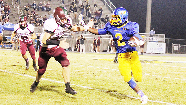 W.S. Neal defeated Satsuma Friday night, 42-21. Above senior runningback Malcolm Hawthorne stiff arms a Gator defender on one of his 11 carries of the night.