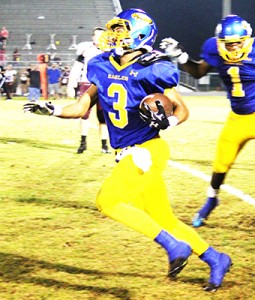 Sophomore Kristian Taylor runs after an interception in the second quarter.