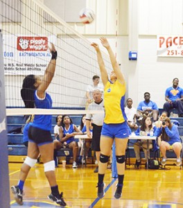 Senior Madison Winchester returns the ball over the net against Atmore
