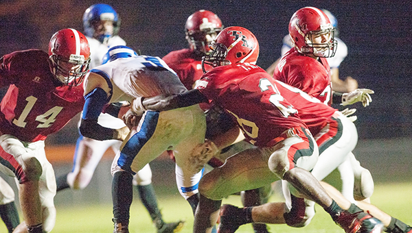 A TRM defender wraps up a Central Coosa runner in Friday nights first round playoff game.
