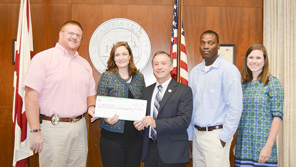 Escambia County CPC members Judge Jeff White and Karean Reynolds and Covington County CPC member Jessie Stephens are pictured with Brewton Police Chief Monte McGougin and Connie Baggett, the city's director of program management.