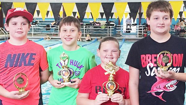 Tigersharks bringing home trophies were (from left) Caleb Kent, Matthew Kirkland, Callie Kent and Patrick Ard.