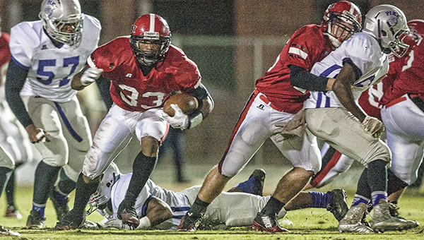 Senior Markail Mitchell eyes an open running lane Friday night against Pike County.