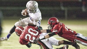 Photo by Sarah Hines Tiger defenders pounce on a Pike County ball carrier.
