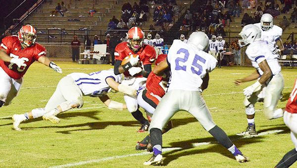 Senior Ahmaud Taylor looks for running room in Friday night's win over Pike County