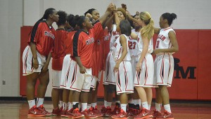 The T.R. Miller Lady Tigers gather prior to a game last season.