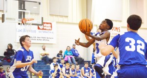No. 3, Li'Terrance McCants of WSNMS goes up for the layup against Jay.