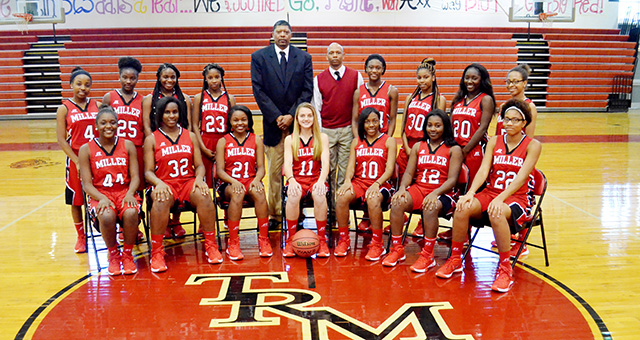 The 2015-16 TRM girls basketball team is pictured with Coach Ron Jackson.