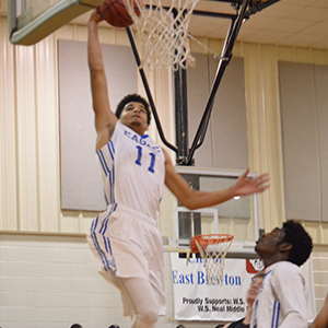 No. 11 Tyshawn Davis goes up for a dunk.