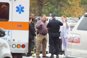 DWM nurse Amanda Morton holds up her injured finger as Chief Deputy Mike Lambert and an unidentified Alabama State Trooper listen to her detail the crash.