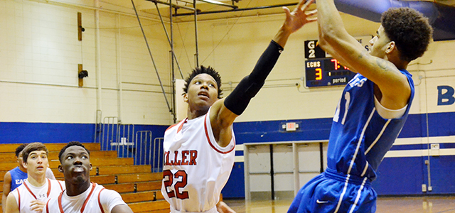 Corey Williams | The Brewton Standard Miller's No. 22 Chardian Johnson defends as Neal's No. 11 Tyshawn Davis takes a fadeaway shot in Thursday's matchup game.