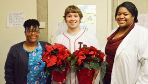Jake Najor with  Kescharnde Drakeford, RN, and Yonechia Cunningham, social services, of West Gate Village.