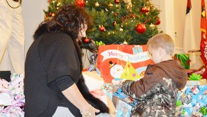 Drug Court Coordinator Denise Carlee helps Byron Pugh with his gifts.