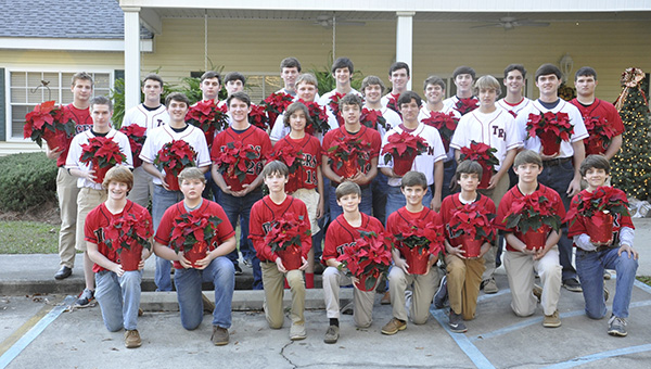 Amy Booker   The Brewton Standard The TRM baseball team visited The Meadows to deliver poinsettias to residents.