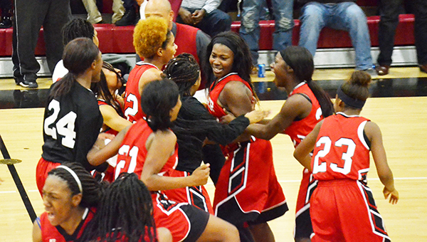 Corey Williams | The Brewton Standard Teammates storm the floor after senior Emonea Curry hits the game winning shot.