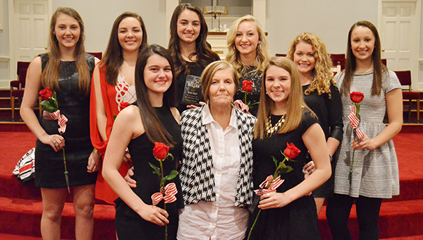 Cheerleaders back row from left to right, Amelia Peach, Baleigh Tubbs, co-captain, Grace Ruzic, Tori Sims, Mary Allison Peace, Denise Floyd. Front row, Tori Knapp and Anna Kate Brittain with sponsor, Beverly Haveard. Not pictured are captain Morgan Manning and Raven Bryant.