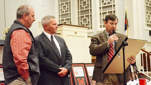 Randy Winton, president of the TRM QB club, is honored with an award by successor Jimbo Hart and head coach Jamie Riggs
