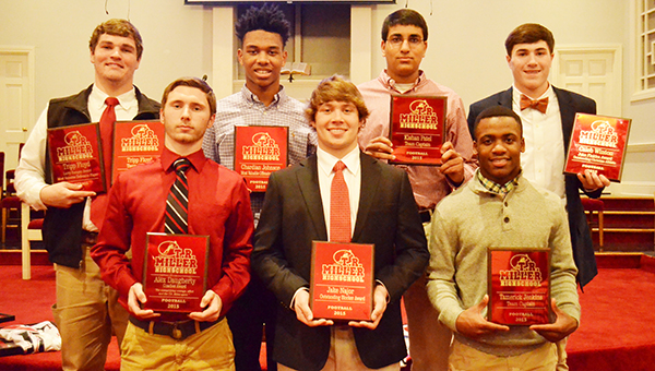 Receiving special football awards were, front left to right: Alex Daugherty (coaches' award), Jake Najor (outstanding blocker) and Tamerick Jenkins (team captain). Back from left, Tripp Floyd (team captain and Larry Rampey most valuable defensive player), Chardian Johnson (most valuable offensive player), Kishan Patel (team captain) and Caleb Winton (John Finklea Outstanding Christian Athlete).