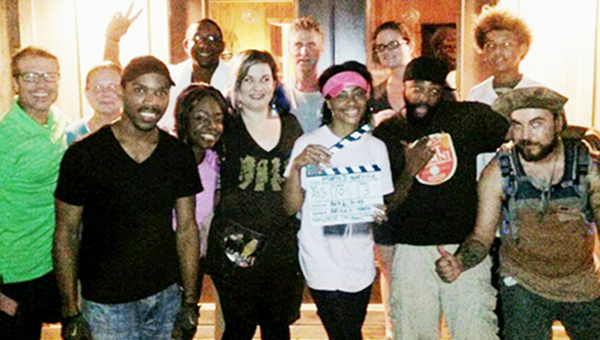 Courtesy photo Director Bea W. Bliss (center) with some cast members and production crew after the wrap of Aborted Traffick.