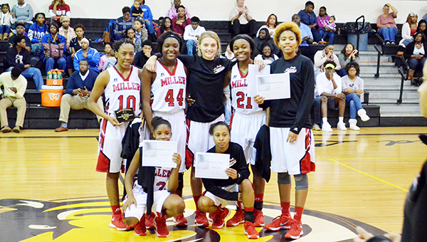 Corey Williams | The Brewton Standard TRM all-tournament girls. Top-left clockwise, Mekhia Williams, Steely Ruzic, Kyla Bell, Janazsia Nettles and Morgan Longmire. Also pictured are #44 Aleria Smith and #21 Mykayla Harrison.