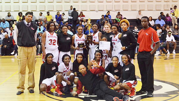Corey Williams | The Brewton Standard The TRM Lady Tigers pose with the championship trophy after their clinching win versus Dothan.