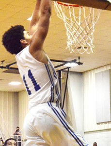 Neal's Tyshawn Davis throws down one of his three dunks for the game. Davis had 24 points for the night.