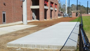 This slab of concrete will be home to the new batting cage.