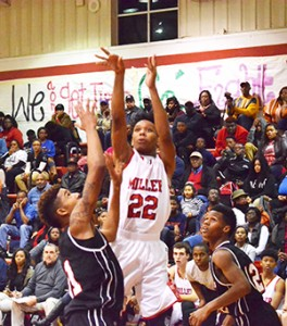 Corey Williams   The Brewton Standard Johnson connects for three of his 41 points Friday night.