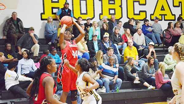 Corey Williams | The Brewton Standard Miller's Aleria Smith raises up for the three pointer in Friday night's win versus opp. The Lady Tigers remain undefeated against area opponents.