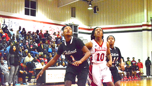 Corey Williams | The Brewton Standard Hillcrest's Tyesha Rudolph and Miller's Mekhia Williams battle for position for the rebound.