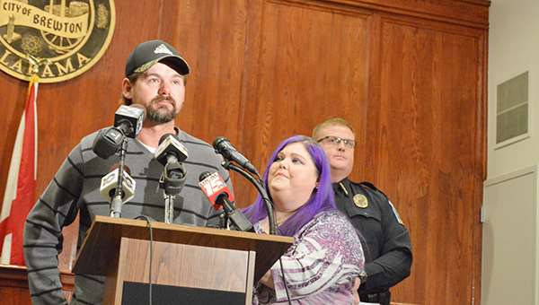 Stephanie Nelson | The Brewton Standard Jimmy and Lisa Bridges, parents of the missing Brewton teen, plead for her safe return Monday as BPD Chief Monte McGougin watches from behind.